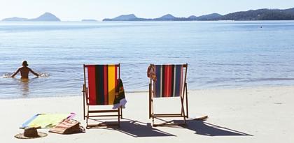 Beach chairs, girl swimming, relaxing
